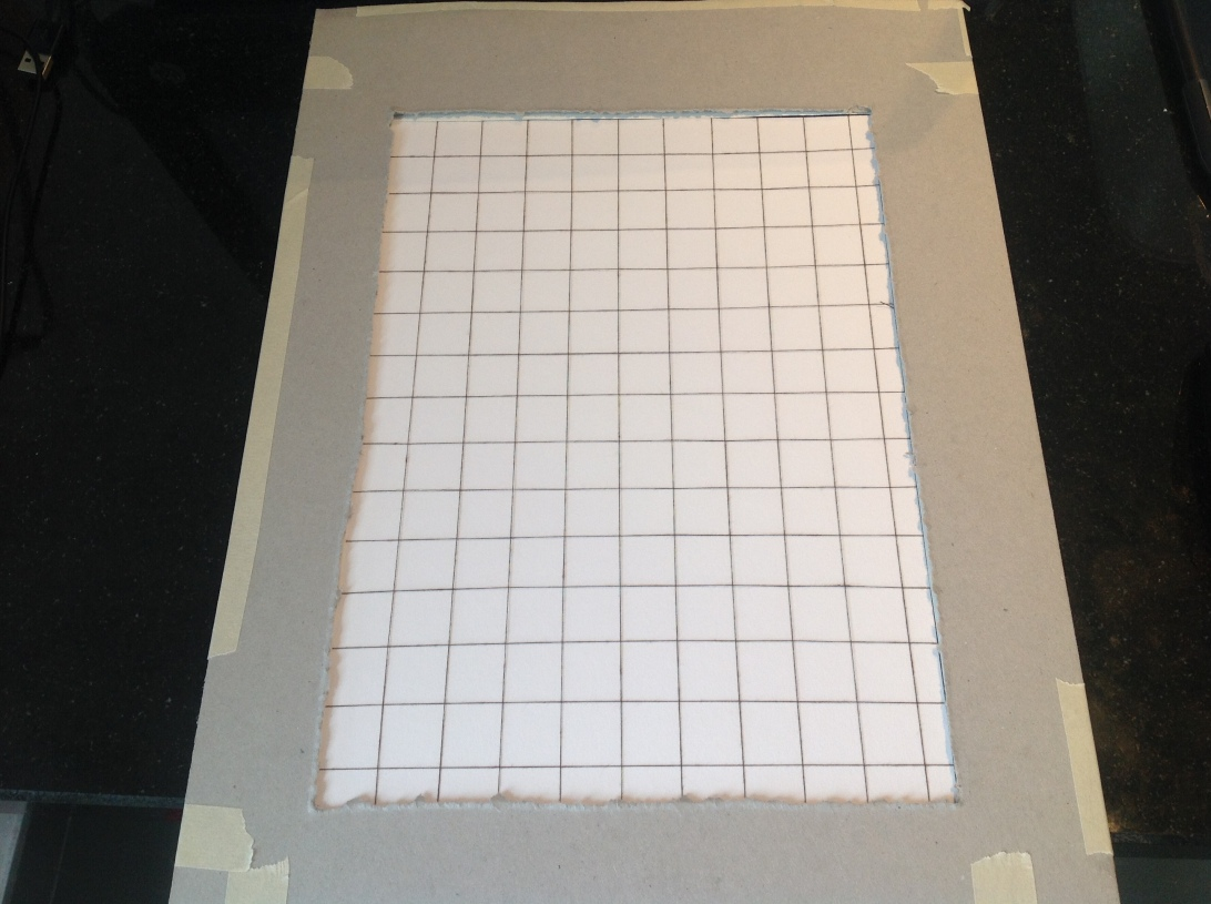Grid tool made from brown thread and cardboard.